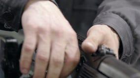 Factory assembly of a Kalashnikov assault rifle. Unlocking assault rifle. Factory worker hand charging machine gun. Factory assembly of a Kalashnikov assault stock video footage