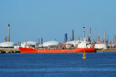 Factory big refinery and carrier ship. Carrier ship for natural gas (tanker LNG Stock Photo