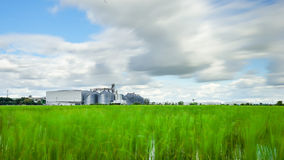 Factory in blur green field with cloud move slowly Stock Image