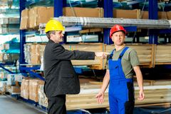 Boss pointing at worker in factory Royalty Free Stock Images