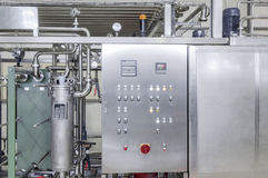 Factory for bottling beverages in cans. The panel with the dashboard in factory  manufacture and bottling of drinks in tin cans. production and bottling of Stock Images