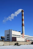 Factory building. With a smoking chimney Stock Photos