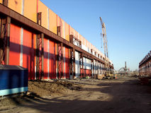 Factory building area. Under blue sky with construction machinery Royalty Free Stock Images