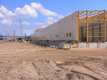 Factory building area. Under blue sky with construction machinery. Laying of foundation Stock Photography
