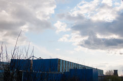 Factory building with clouds Stock Image
