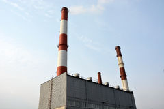 Factory building with smokestacks Royalty Free Stock Photo