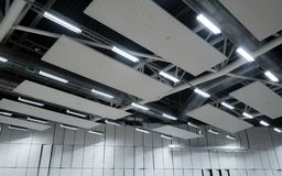 Factory building or warehouse building. Vast empty space with ventilation pipes and lights stock image