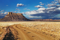 Factory Butte. Isolated flat-topped sandstone mountain in Utah desert, USA royalty free stock images