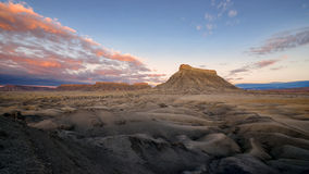 Factory Butte. Isolated, flat-topped sandstone peak near Caineville, Utah Stock Image