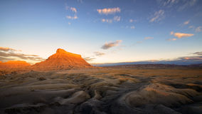 Factory Butte. Isolated, flat-topped sandstone peak near Caineville, Utah royalty free stock photos