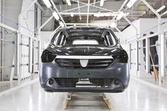 Factory car painting. Painting cars in modern car factory royalty free stock photos
