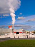Factory with a chimney. And white smoke Stock Photo