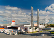 Factory with a chimney. And smoke in sunny day Royalty Free Stock Photos