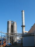 Factory chimney. The factory chimney photographed on a background of the blue sky Stock Images