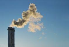 Factory chimney. Urban chimney-stalk on a background blue sky Stock Photography