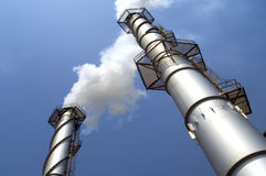 Factory Chimney. Blows white smoke royalty free stock photography