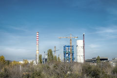 Factory chimney and a crane Royalty Free Stock Photography