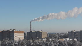 Factory chimney fumes over the city stock footage