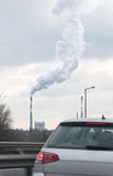 Factory chimney polluting air Stock Photo