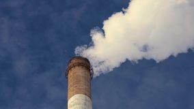 Factory chimney on the sky stock footage