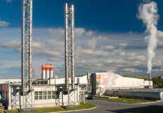Factory with a chimney and smoke. Factory with a chimney and white smoke Stock Images