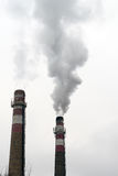 Factory chimney with smoke Royalty Free Stock Photos