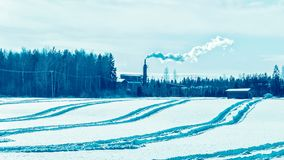 Factory chimney and the steam winter countryside in Finland, Lapland. Factory chimney and the steam in winter countryside in Finland, Lapland royalty free stock photography