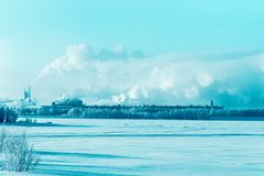 Factory chimney and the steam winter countryside of Finland, Lapland. Factory chimney and the steam in winter countryside of Finland, Lapland royalty free stock images