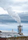 Factory. Chimney with white smoke coming out blue sky stock photo