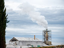 Factory. Chimney with white smoke coming out blue sky stock images