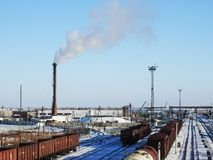 Factory chimney, WHITE thick smoke on the sky, RAILWAY STATION, RAIL, CARRIAGE stock photography