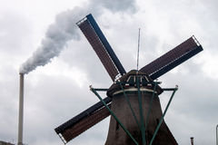 Factory chimney and wind mills Royalty Free Stock Photography