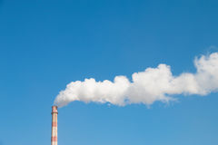 Factory chimney in winter Stock Photo