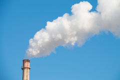 Factory chimney in winter Royalty Free Stock Image