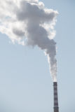 Factory chimney in winter Stock Image