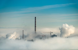 Factory chimneys and clouds of steam Royalty Free Stock Photos