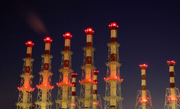 Factory chimneys at night Stock Image