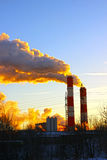 Factory chimneys smoke rising into the sky Stock Photos