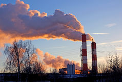 Factory chimneys smoke rising into the sky Royalty Free Stock Photo