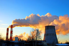 Factory chimneys smoke rising into the sky Stock Photography