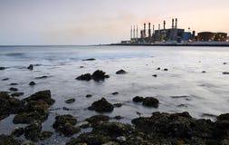 Factory on the coast Royalty Free Stock Photos