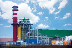 Factory with colorful tower and metallic tubes Royalty Free Stock Photography