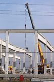 Factory construction site with crane and worker. New factory construction site with crane and worker Royalty Free Stock Photos