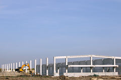 Factory construction site with excavator Royalty Free Stock Images