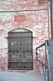 Factory Door. An old door to an abandoned factory along the river shore in south Brooklyn in New York City royalty free stock image