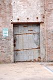 Factory Door. An old door to an abandoned factory along the river shore in south Brooklyn in New York City royalty free stock photography