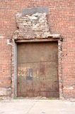 Factory Door. An old door to an abandoned factory along the river shore in south Brooklyn in New York City stock photos
