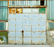Factory door. Rusted blue  metal factory door Stock Images