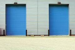 Factory doors. Two blue factory doors as a background royalty free stock photos