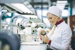 Factory electronics worker. Fix make female smile Stock Photo